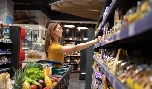 woman-with-shopping-cart-buying-food-at-supermarket